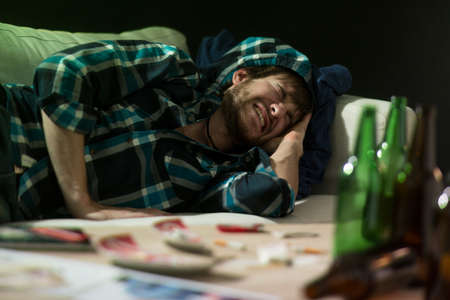 after party: Young student having terrible headache after party Stock Photo