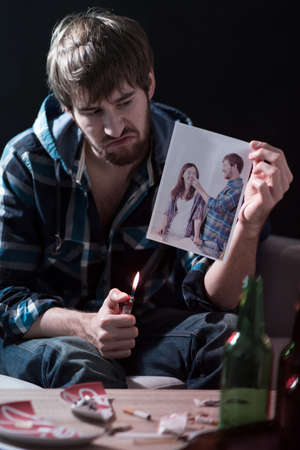 burning man: Picture of drunk man burning ex-girlfriend photo Stock Photo