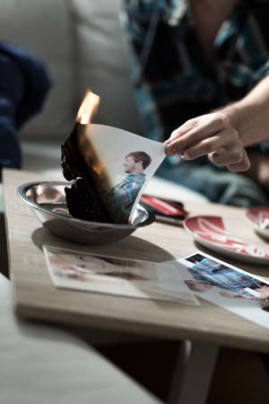 split up: Man burning photo with ex-girlfriend after split up