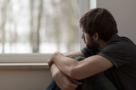 Portrait of young man suffering for depression Stock Photo