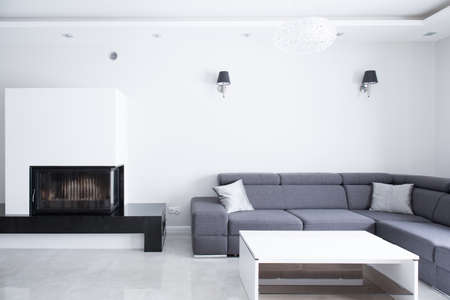 fireplace family: Elegant big lounge with grey comfortable corner sofa