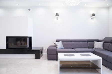 corner house: Photo of white and grey simple living room