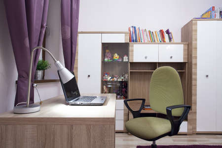 home office desk: Photo of modern study room with wooden furniture