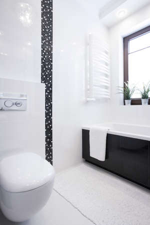 White porcelain toilet in new small clean bathroom photo