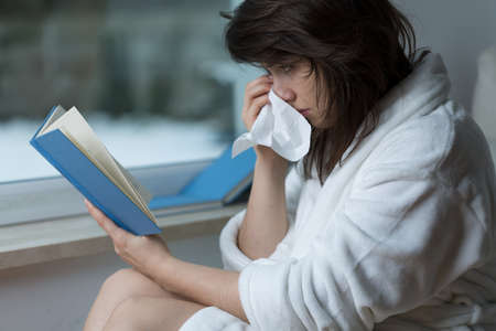beautiful crying woman: Sensitive young woman reading romance and crying