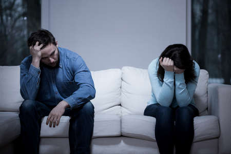 relationship breakup: Picture of young couple having difficulties in relationship Stock Photo