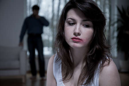 bully: Horizontal view of victim of domestic abuse Stock Photo