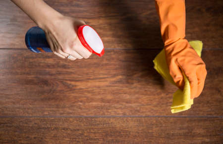 domestic staff: Using rag for cleaning dusty wood in home Stock Photo
