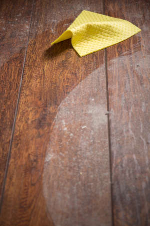 rags: Dust and yellow rag on wooden parquet Stock Photo