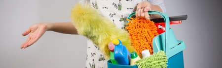 Woman preparing to clean the house with household equipment