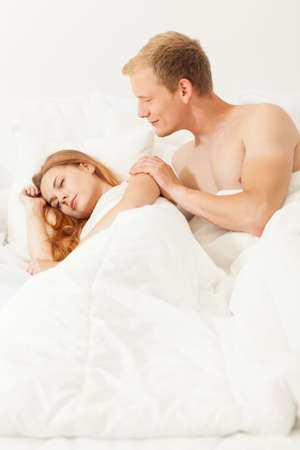 morn: Men waking up his beautiful lover gently Stock Photo