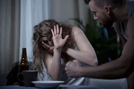 beaten woman: Aggressive man fighting with his scared woman