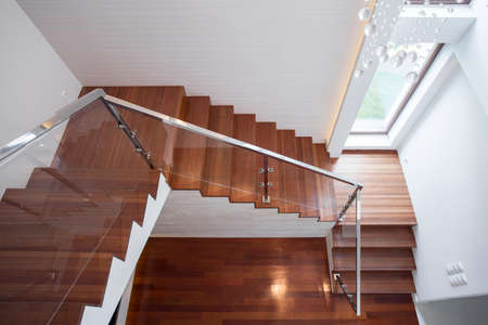 Close-up of wooden stairway in luxury house 스톡 콘텐츠