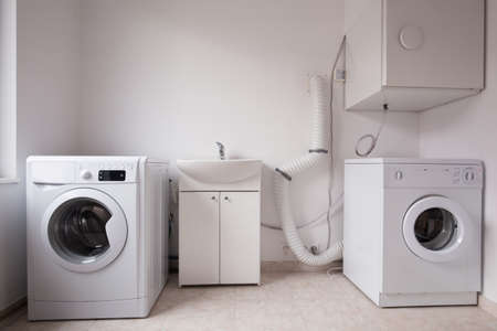 laundrette: Close-up of automatic washing machines in laundry Stock Photo
