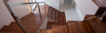 Wooden staircase in exclusive detached house - panorama