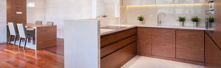 commodious: Wooden modern interior - kitchen and dining room