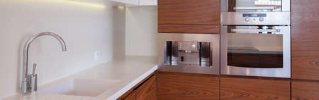 countertops: Close-up of white and brown luxury kitchen