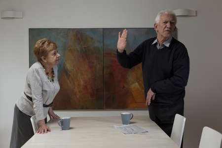 Senior disputing couple having problems in marriage photo