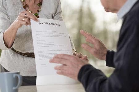 Elderly woman demanding divorce form her husband Stock Photo