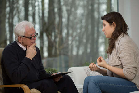 Young women uses individual psychological counseling Imagens