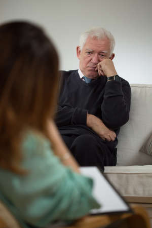mental disorder: Elderly man talking with psychotherapist