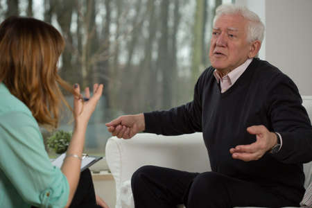 neurosis: Psychological interview with elderly man Stock Photo