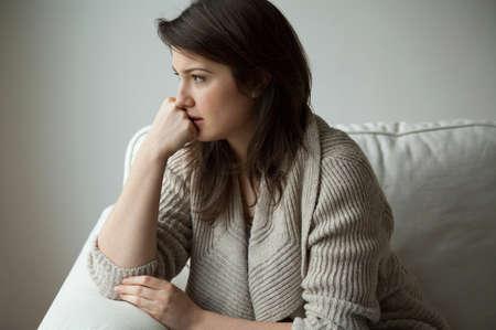 Portrait of melancholy women sitting alone