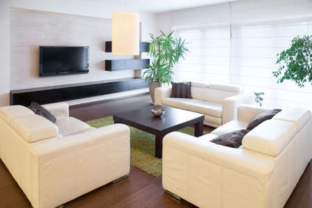 condos: Comfortable white sofas at living room