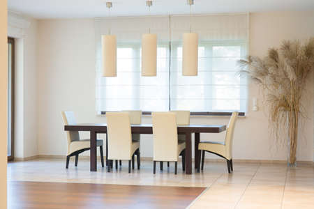 parter: Luxury dinning room with big oak table Stock Photo