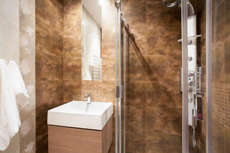 Marble bathroom with shower and sink