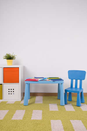 Small cute furniture in cozy toddlers playroom photo
