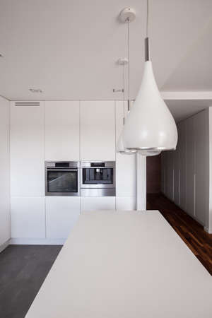 countertop: Close-up of white countertop and kitchen unit