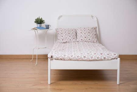 girl bedroom: White freestanding bed in cozy teen room
