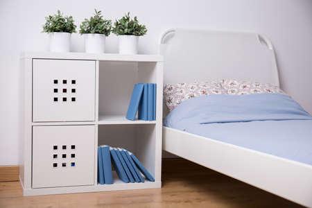 teen bedroom: Close-up of white furniture in teen bedroom Stock Photo