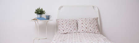 headrest: Panoramic view of white bed with floral bedding