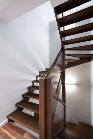 Close-up of spiral wooden stairs in luxury residence