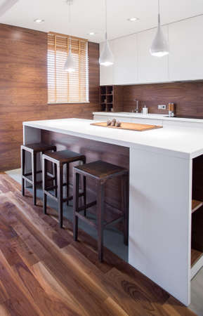 vertical: Elegant wooden kitchen interior in traditional house Stock Photo