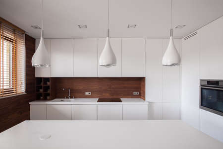 Beauty white traditional kitchen with wooden details