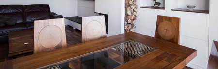 Horizontal view of antique wooden dining table photo