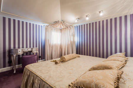 spacious: Spacious baroque style bedroom with double bed Stock Photo