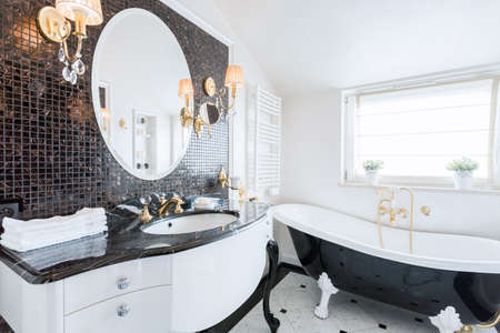 bathtub old: Stylish washroom with big black and white bathtub Stock Photo