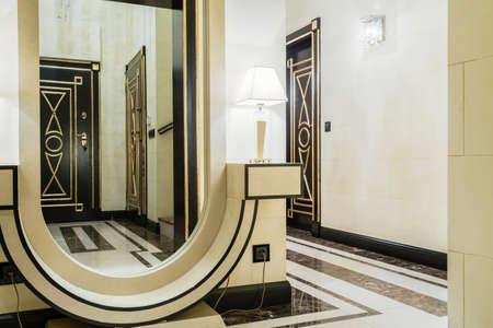 anteroom: Big extravagant mirror in new modern entrance hall Stock Photo