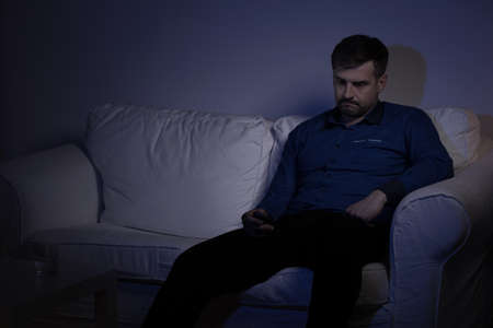 Image of lonely man spending evening alone