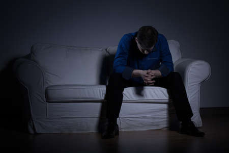 depressed man: Image of despair man thinking about his problems Stock Photo