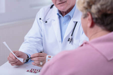 medic: Medic talking with patient in doctors office Stock Photo