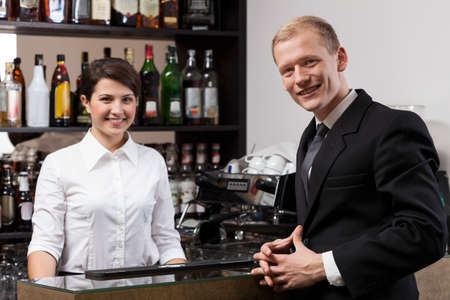 restaurant industry: Young pretty waitress and handsome businessman Stock Photo