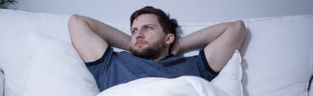 Young attractive man suffering from insomnia photo