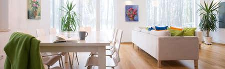 Panoramic photo of spacious cozy untidy living room