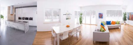 Panoramic photo of modern kitchen connected with spacious lounge