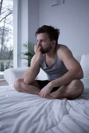restless: Young handsome tired man after restless night Stock Photo